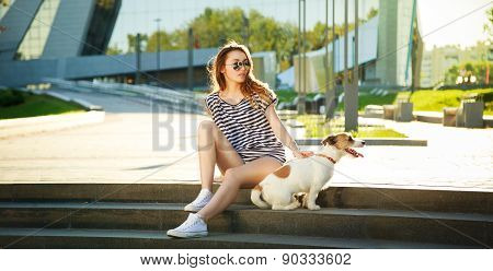 Hipster Fashion Girl with her Dog in the City