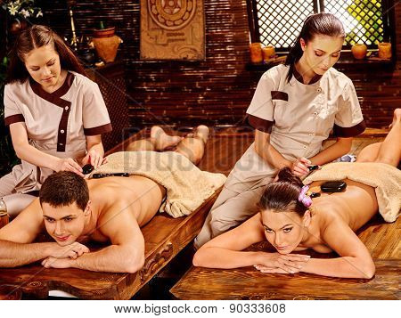 Couple man and woman having oil Ayurveda spa treatment.