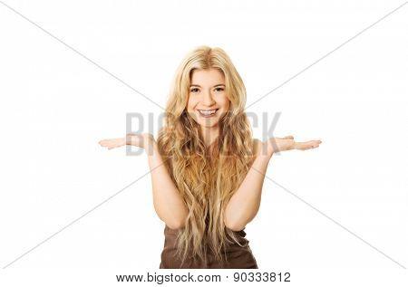 Portrait of student woman holding copyspace.
