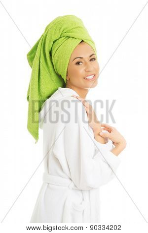 Portrait of a woman in bathrobe looking at camera.