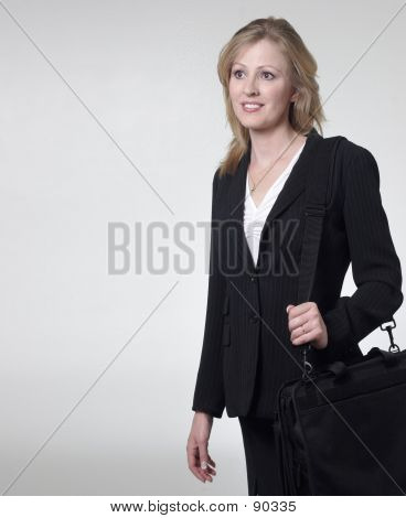 Smiling Lady Lawyer Carrying Briefcase