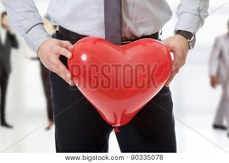 Young man with heart balloon.