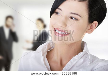 Young cheerful smiling woman looking away.