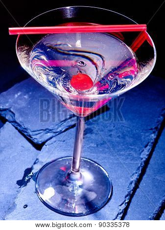 Transparent cherry cocktail on black background. Top view. Cocktail card 48