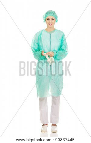 Caucasian woman doctor wearing medical gloves.
