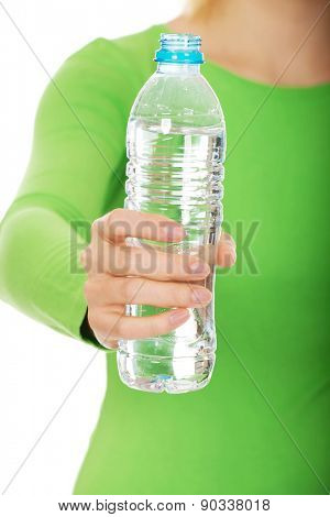 Caucasian woman holding a bottle of water.