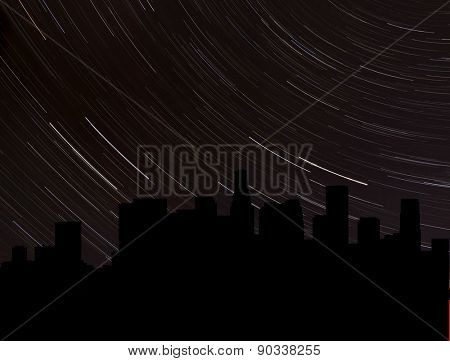 Los Angeles skyline silhouette with star trails illustration