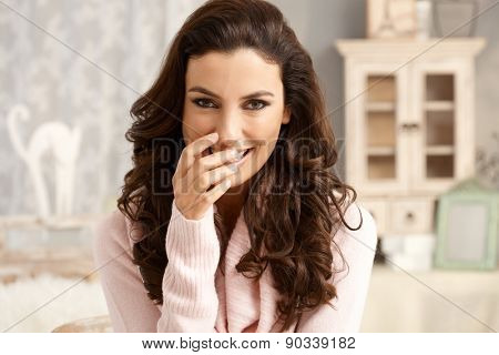Portrait of attractive young woman with a shy smile.