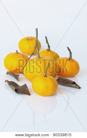 Ripe Orange With Leaves Isolated On White