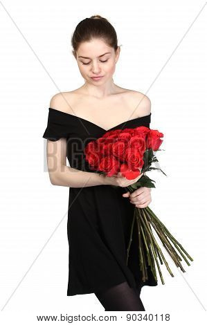 Beautiful brunette in a black dress with a large bouquet of roses