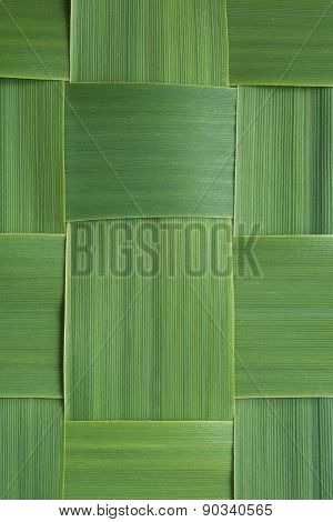 Close-up pattern of woven grass leaves