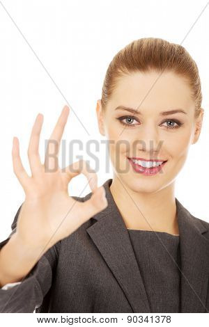 Happy business woman showing perfect hand sign.