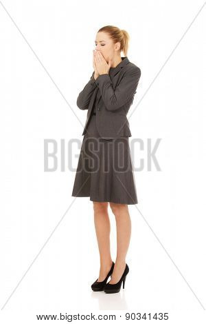 Tired yawning business woman in a suit.