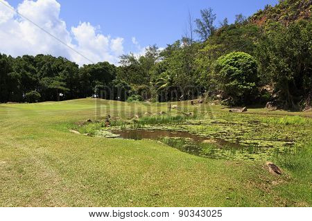 Lake on golf course at the Constance Lemuria Resort.