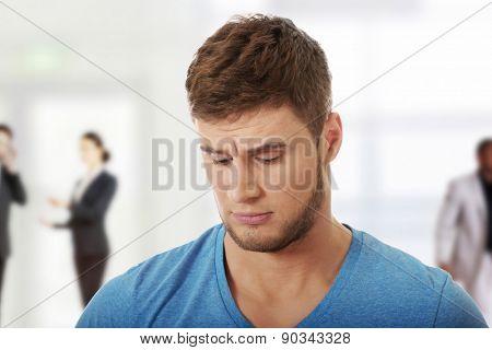 Handsome young caucasian depressed man.