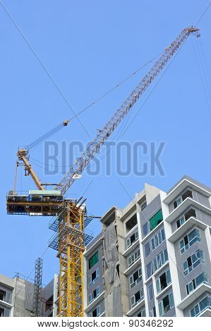 Big Crane And Incomplete Skyscraper With Blue Sky