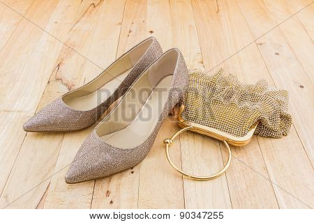Collection Of Golden Shoes And Bag.