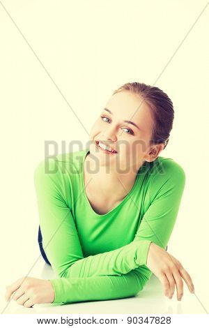 Happy laughing woman lying on her belly.