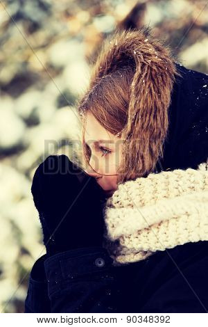 Teenager drinking hot drink in the winter outdoors