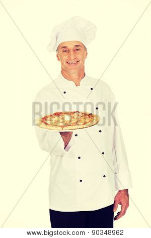 Chef baker with italian pizza on plate.