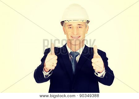 Mature engineer businessman showing ok sign.