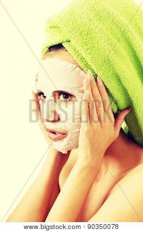 Portrait of a woman with revitality face mask.
