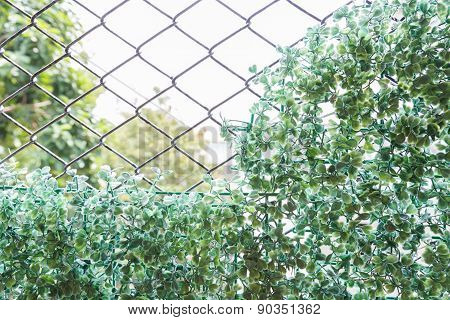Fake Plant On Wire Fence For Background