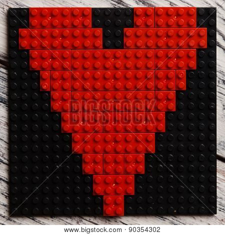 Heart of red plastic bricks