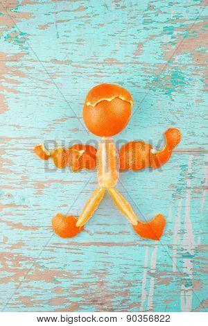 Human Figure Made Of Fresh Orange Slices And Peel