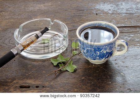 E-cigarette Cup Of Coffee On A Wooden Background Healthy Lifestyle