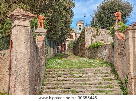 Entrance To The Church Of A Country Village In Tuscany, Italy