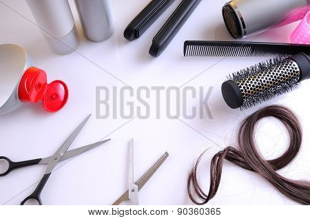 Set Hairdressing Articles Around A White Table Top View