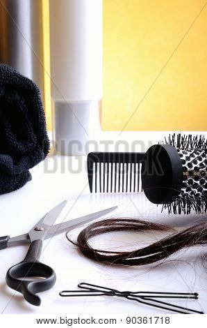 Set Hairdressing Articles On Glass Table Vertical Composition