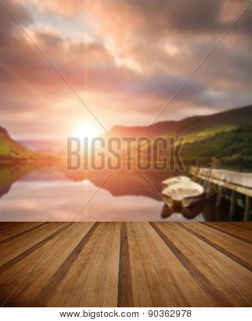 Sunrise Over Lake With Boats Moored At Jetty With Wooden Planks Floor