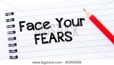 Face Your Fears Text Written On Notebook Page