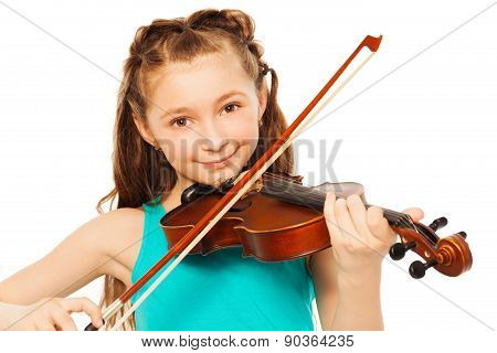 Beautiful girl with long hair playing on violin