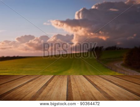 Stunning Landscape With Stormy Sky Over Rural Hills With Wooden Planks Floor