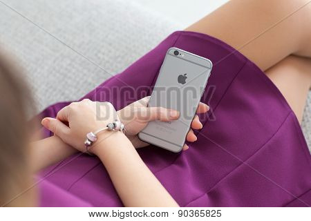Woman Sitting And Holding A New Iphone 6 Space Gray