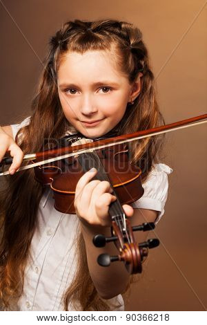 Girl with long hair plays violin on gel background
