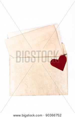 isolated vintage envelope with red paper heart