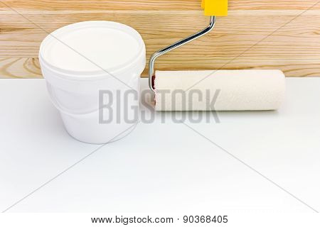 Plastic Can Of Paint With Paint Roller