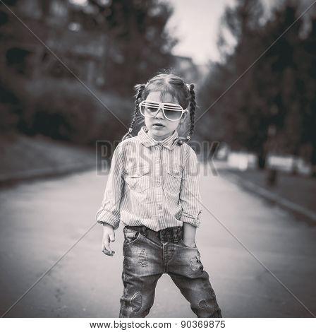 Little Pretty Girl Walking On The City Street