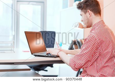 Office worker working on computer in office