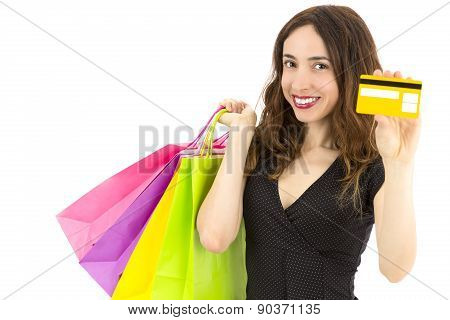 Woman With Shopping Bags Showing Credit Card