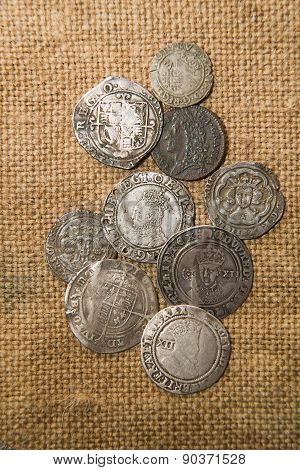 Ancient Silver Coins With Portraits Of Kings On The Old Cloth