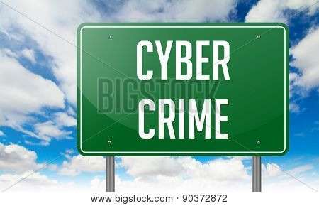 Cyber Crime on Green Highway Signpost.