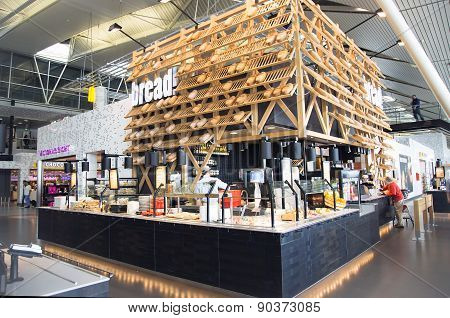 Modern airport hall with interesting cafes and shops