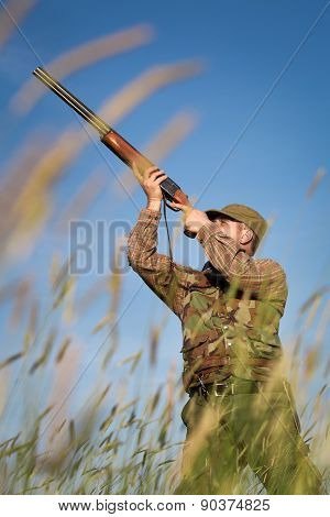 Male hunter on the hunting field