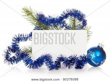 Fir-tree branch with tinsel