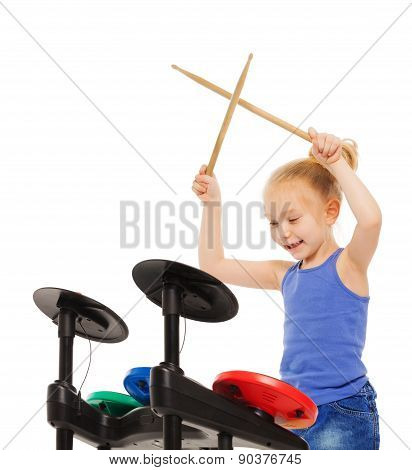 Happy blond girl plays with drumsticks on cymbals